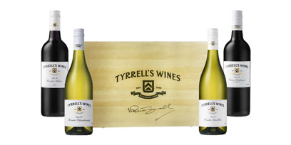 A Bruce Tyrrell signed wooden gift box with 4 bottles of Tyrell's Wines