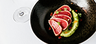 Peppered tuna loin served with avocado mousse, micro celery finished with                a splash of green onion olive oil.