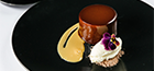 Chocolate delice, caramelized milk, Marsala and mascarpone mousse, coffee                and chocolate soil.