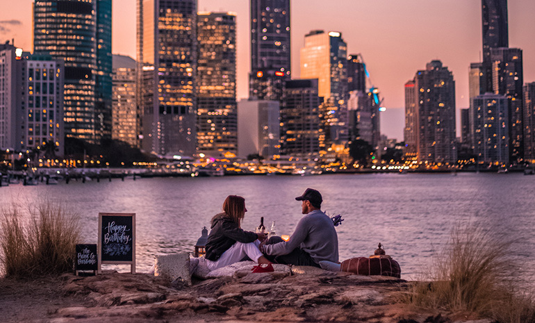 A couple having a picnic on the Brisbane River