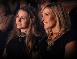 A mother and daughter in the audience at the opera