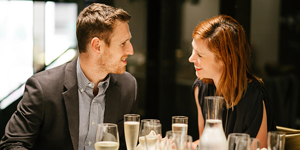 A couple enjoy dinner and wine before a performance at Arts Centre Melbourne