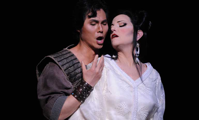 Yonghoon Lee as Calaf and Lise Lindstrom as Turandot embrace in costume
