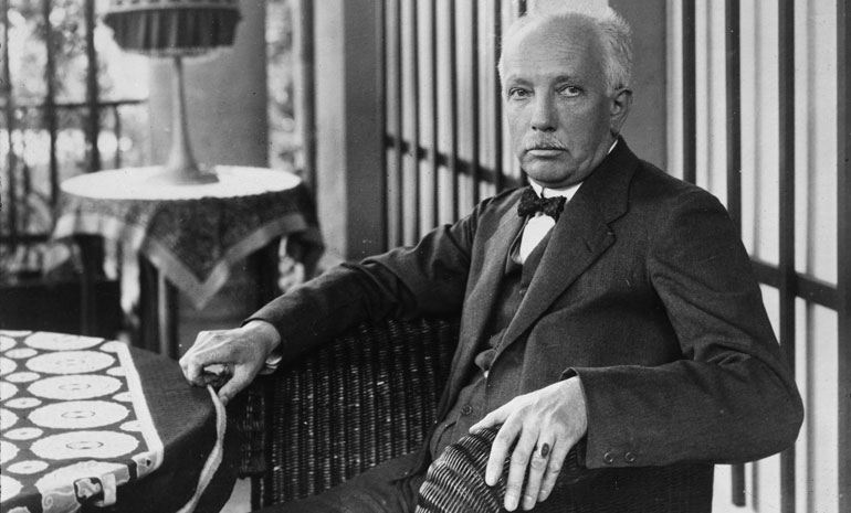 A photograph of Richard Strauss at table