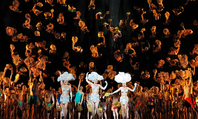 A production image from Das Rheingold featuring the Rhinemaidens and the Sea of Humanity.