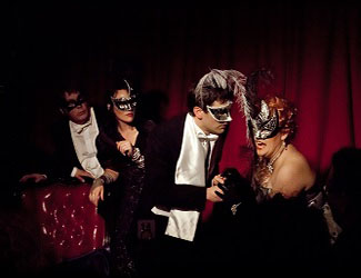 Guests wearing theatrical masks at the opera